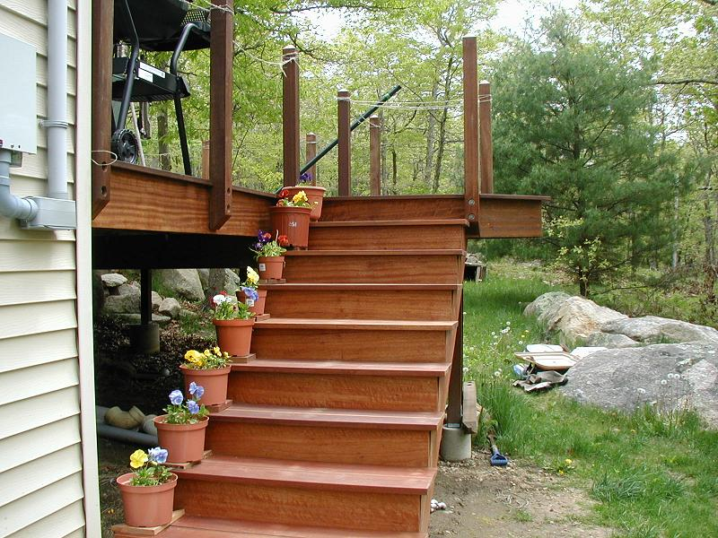 these are the steps to the backyard from the overlook handrail is